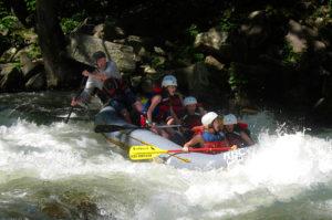 Camp kids whitewater rafting trip