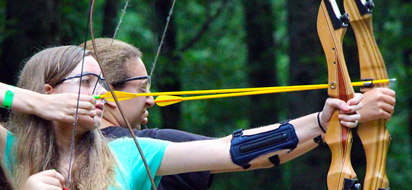 Pair of girls shooting archery