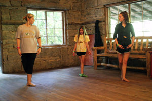 Dance counselors teaching girl