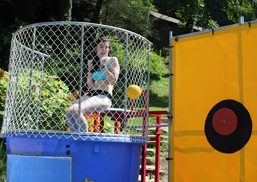 Camp counselor girl in dunking booth