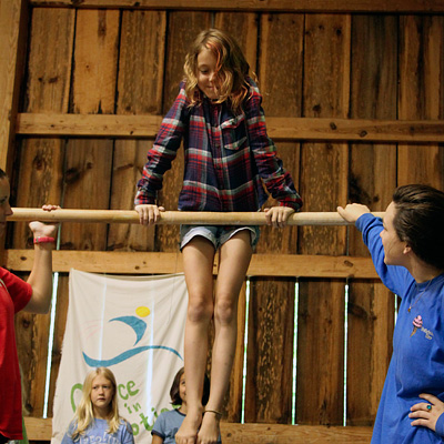 Camp girl on gymnastics bar