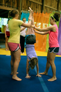 Gymnastics camper doing handstand