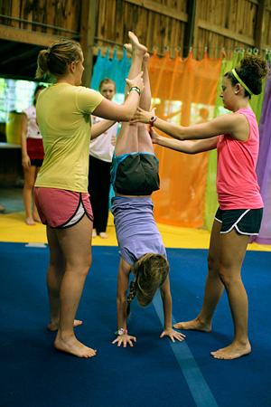 Gymnastics camper doing handstand
