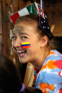 Camper with flags in her hair