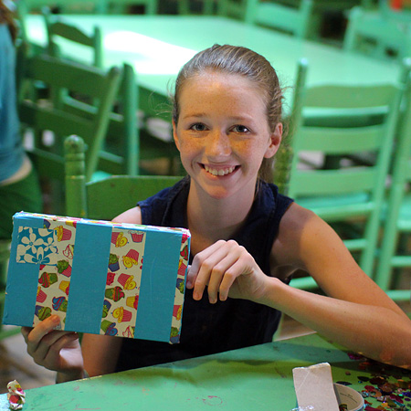 Girl holding a decorated paper box