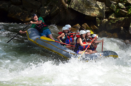 Girls Whitewater rafting rapid