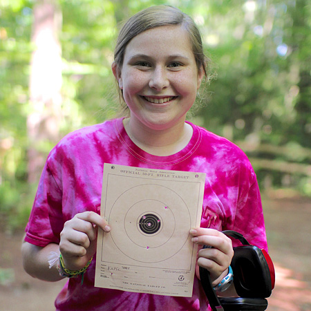 Kid holding her riflery target