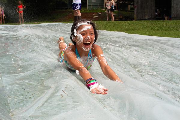 Girl camp slip n slide