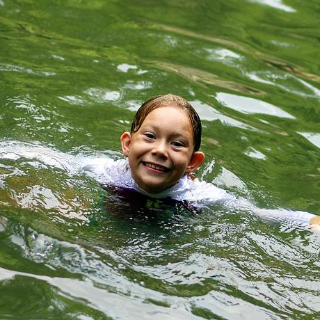 Girl swimming at summer camp