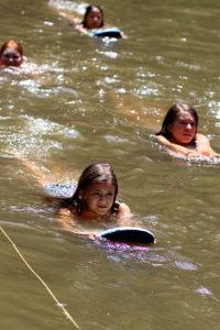 Kids swimming class in lake