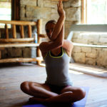 Girl doing yoga at summer camp