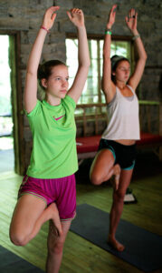Camp girls yoga pose
