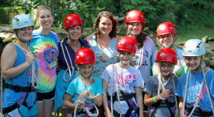 Crew of girls ready for the camp zip line
