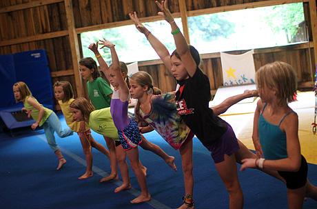 Learning gymnastics at summer camp