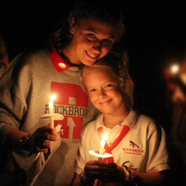 Camper and counselor at closing campfire