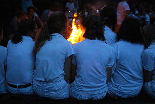 Campfire girls dressed in white