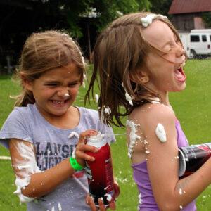 Girls shaving cream fighting