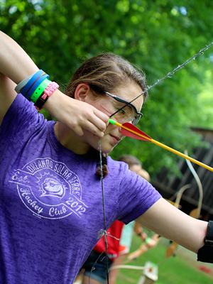 archery camp girl shooting