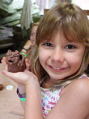 Camper proudly displays pottery sculpture