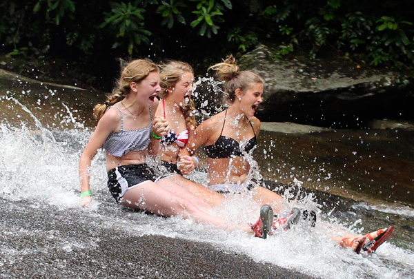 Girls Sliding Down the Rock