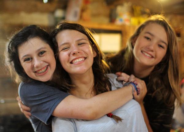 Camp friends hugging