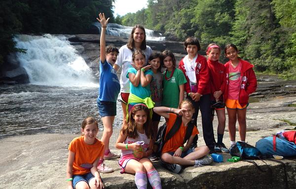 Kids Hiking by Waterfall