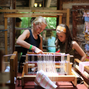 Girls working on loom weaving