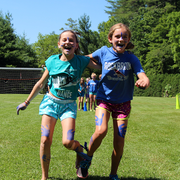 Campers running 3-legged race