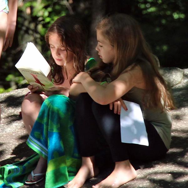 Girls reading during free time at camp