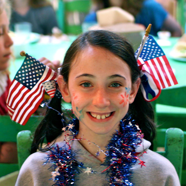 USA Flag in Hair of Girl Camper