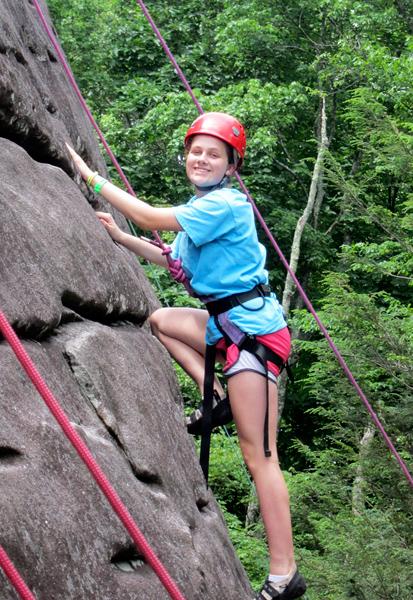 Camp girl rock climbing
