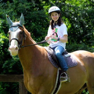 Summer camp horseback riding girl