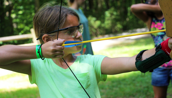 Junior camp girl shooting archery