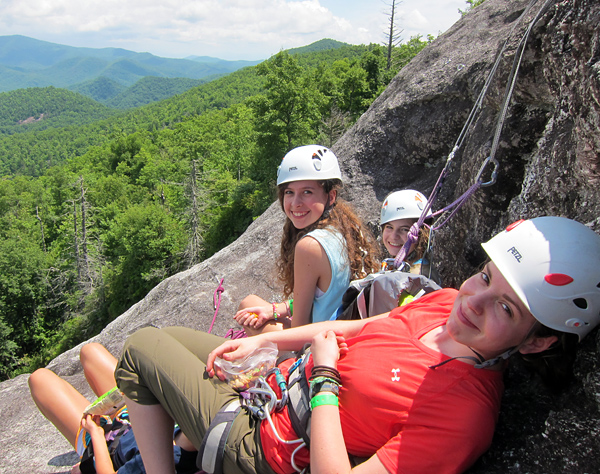 Camp girls rock climbing multi-pitch route