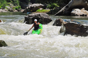 Camp Girl whitewater kayaking on the nolichucky