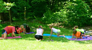 Outdoor Yoga session at summer camp