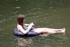 Reading a book floating in the lake