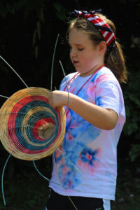 Camp girl making a USA basket