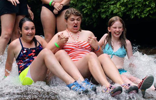 Girls Grimacing on Sliding Rock
