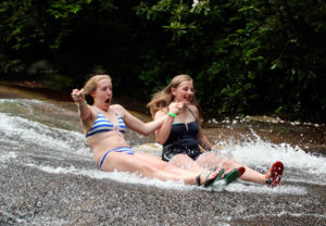 Girls grinning on sliding rock