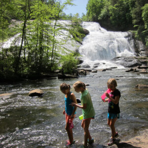 Camp girls exploring a waterfall