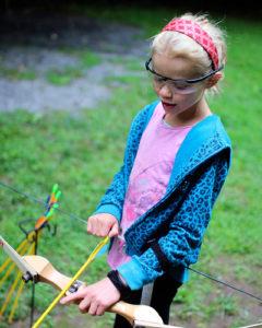 Camp kid shooting archery