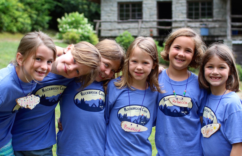 Young girls camp friends