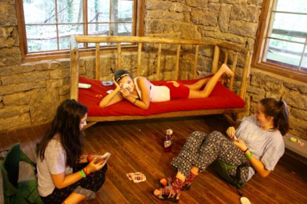 Girls playing cards at slumber party