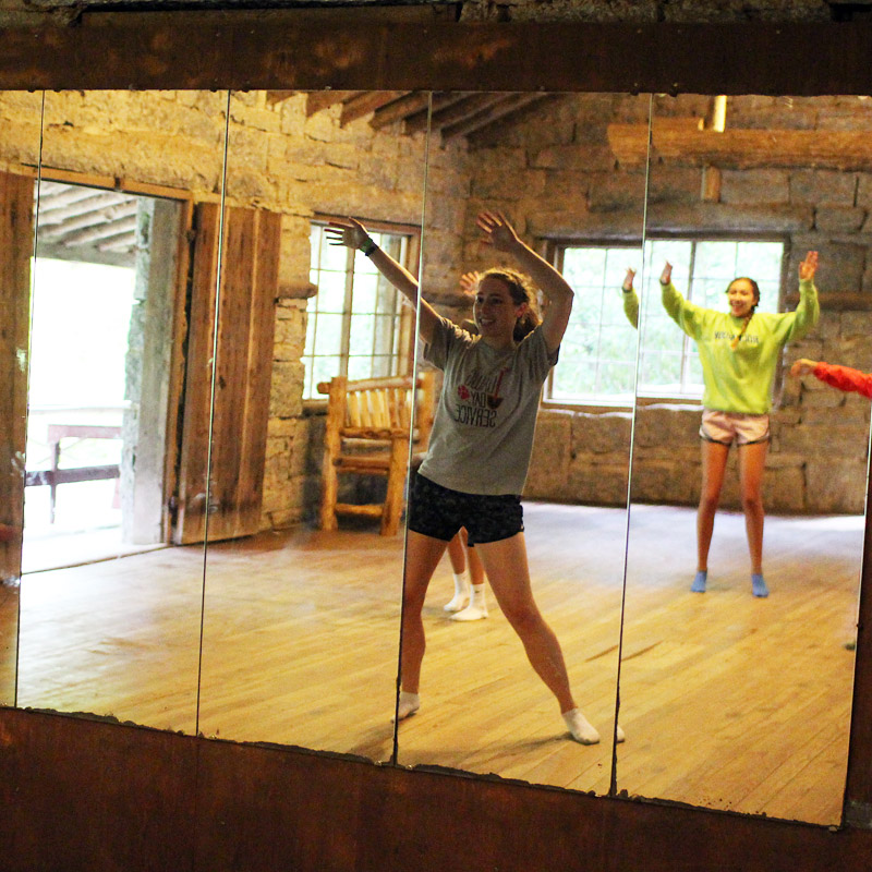 Camp dancing girls in mirror