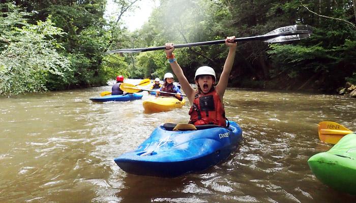 Teen Girl kayaking celebration