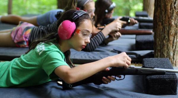 Girl Loading a Gun