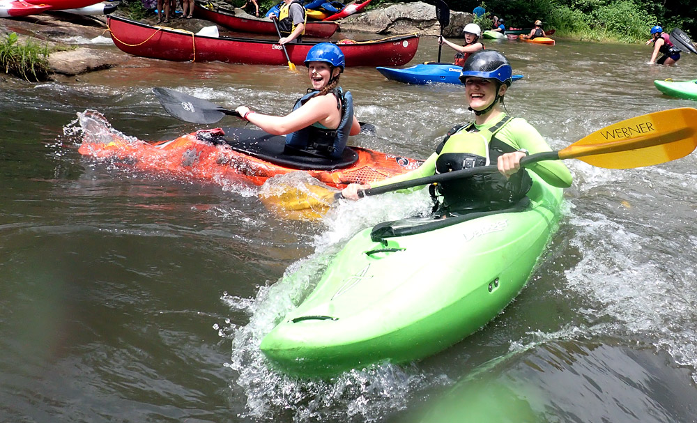 Kayaking surfing whitewater wave