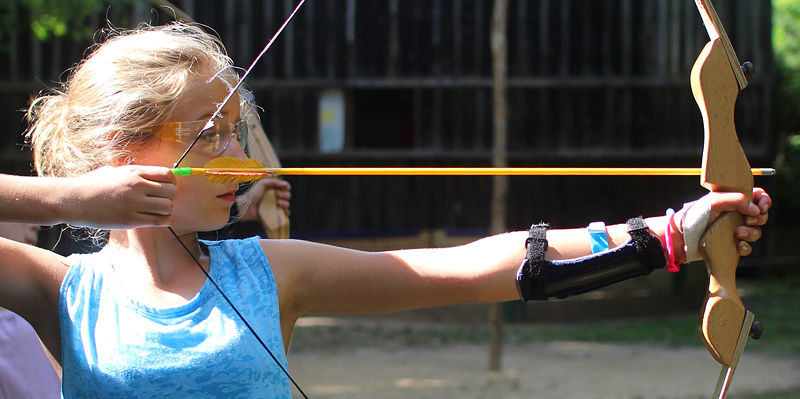 Girls Aiming Archery bow and arrow