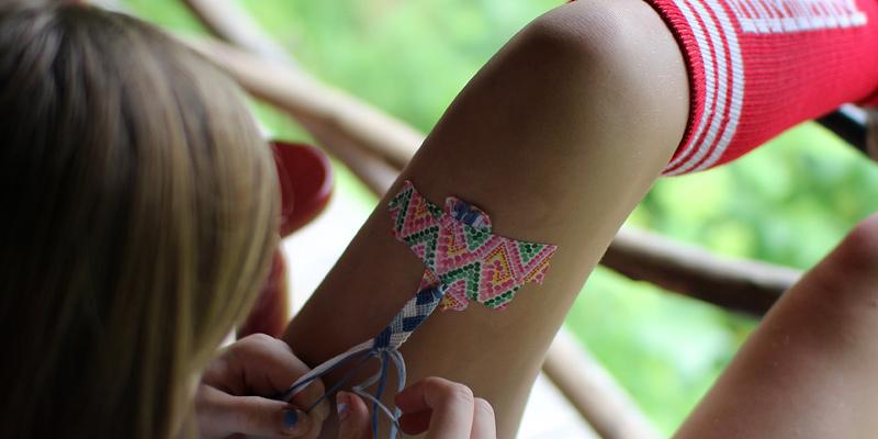 Bracelet making taped to leg